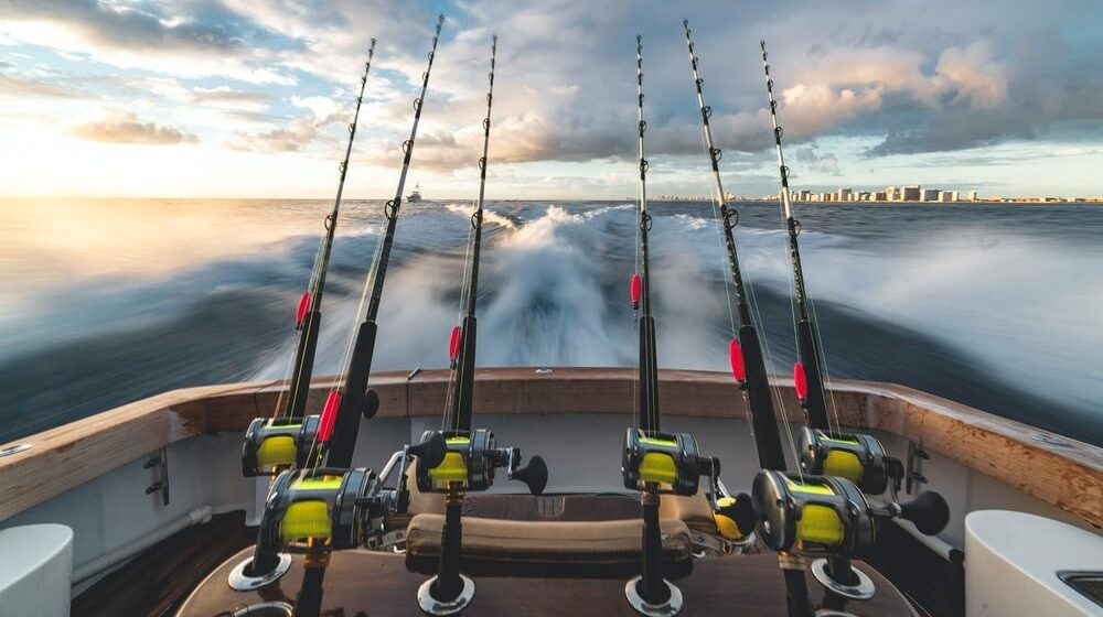 Fishing poles on a boat cast out in the ocean